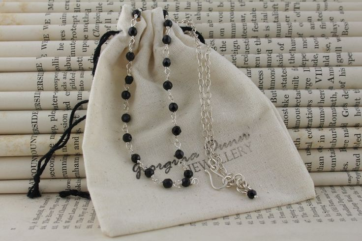 delicate black onyx necklace on bag.jpg