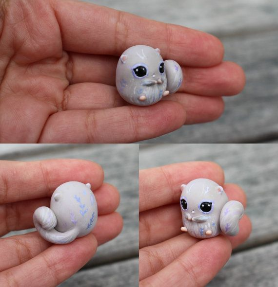 This little ball is based on a Japanese flying squirrel, but has little blue and lavender details in its fur.  It will come glazed and carefully packaged!  -This little cutie is approximately 2.5cm tall!  ❤❤❤  Follow me on Instagram for news, updates & follower goodies: http://instagram.com/thelittlemew  Have a WONDERFUL day