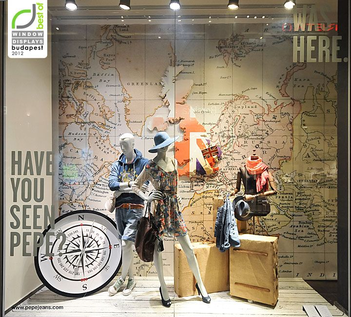 Mixed-use building? This would be great @ retail level with a neighborhood map!   Pepe Jeans window displays Summer 2012 Budapest