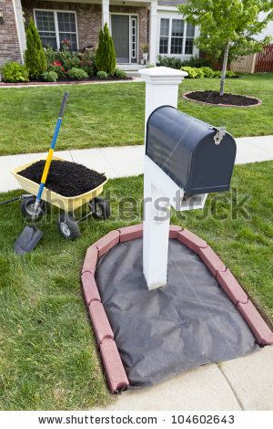 Laying Mulch Around The Mailbox And Placing Edger Bricks. Stock Photo 104602643 : Shutterstock