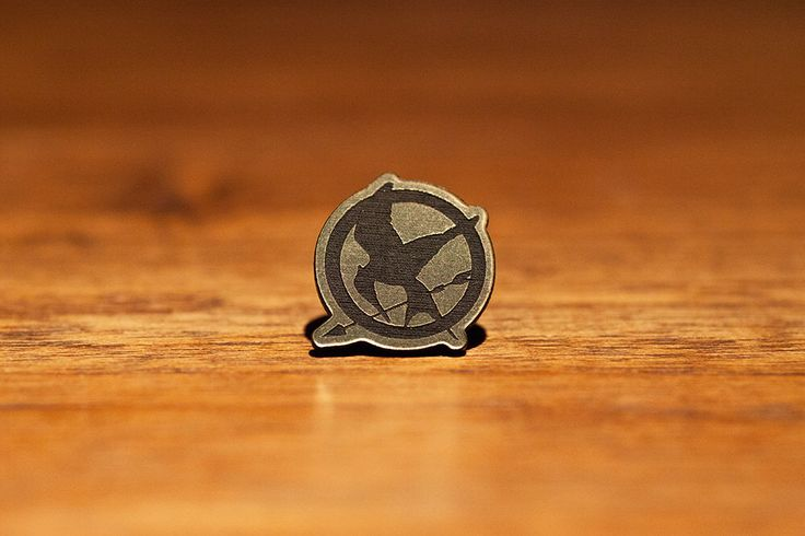 Hunger Games Mockingjay Pin Katniss Everdeen Peeta Mellark Panem Dystopia Capitol District 13 Dark Days Haymitch Abernathy Snow Prim Cosplay by interstait on Etsy https://www.etsy.com/listing/482116621/hunger-games-mockingjay-pin-katniss