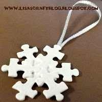 Snowflake ornament made from white-painted puzzle pieces.  Genius!