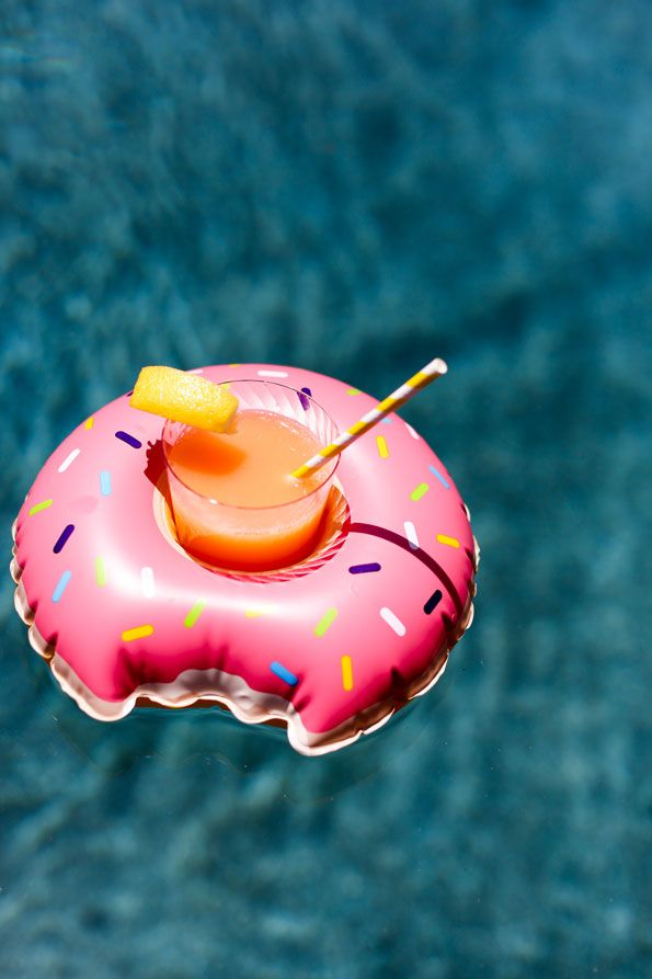 Keep the pool party poppin' with summer activities. Fill your pool with fun floaties like large inflatable swans and donuts (especially if your friends will be bringing their children). But who said adults can't have fun floating around too?! Evite Pool Party Guide