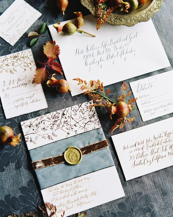 Lily Lasuzzo of Lavender & Mint designed all of the wedding's stationery, and was inspired by Northern California'sromantic atmosphere,and the bride's bohemian-style dress. They collaboratedwith Signora e Mare, whose calligraphy gave the stationery an old-world feel. A matte gold foil stamp,black letterpress, a moiré silk ribbon and skinnier velvet ribbon, and a custom gold wax seal pulledthe decidedly vintage suitetogether.