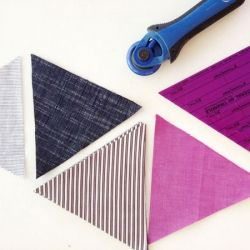 Ever wanted to make a triangle quilt? This tutorial shows you how to plan and cut your fabric and includes PDF templates.