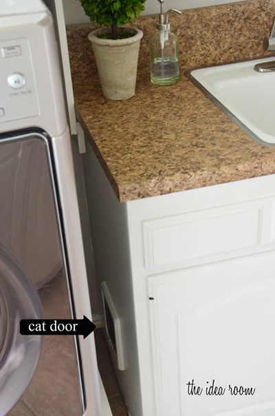 cat door under laundry room sink for litter box