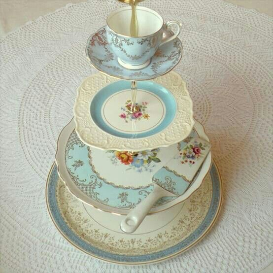 Homemade cake stand from vintage items.  Put large flower in the teacup! make this from grandma's old set or from someone you love.a real keeper.