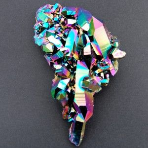 titanium flame aura quartz.  It is a quartz that has been treated with titanium.  Used in meditation to stimulate the movement of the kundalini to the crown chakra.  It also carries the cleansing properties of natural quartz crystals: alignment and harmony etc