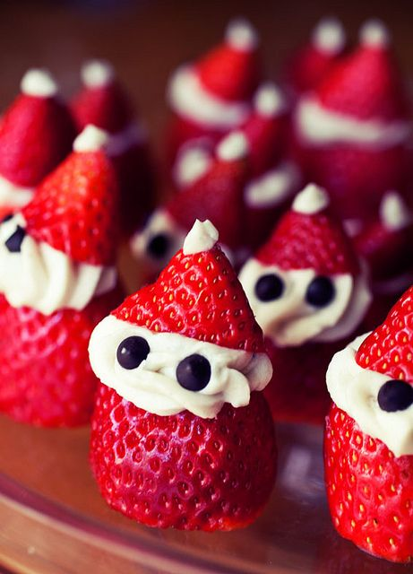 Every year I make a strawberry dessert for my best-friends Christmas party. This year I made these little guys and they were so easy and hilarious- they were the talk of the whole dessert table! No joke! ~ Gina ~