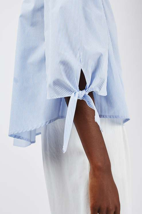 Make an instant style statement in this striped poplin Bardot top with cute tie sleeve detail. In a summery light blue hue, we love to wear it with white culottes and matching white mules for a crisp tailored look. #Topshop