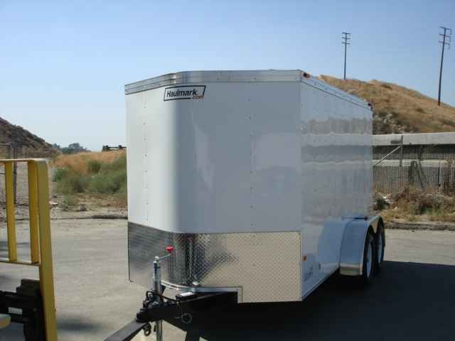 "2016 New Haulmark TSV6X12DT2 Toy Hauler in California CA.Recreational Vehicle, rv, 2014 HAULMARK TSV6X12DT2, HAULMARK TSV6X12DT2 TRANSPORT DLX WITH A DUAL SPRING ASSISTED RAMP DOOR W/16"" PLYWOOD EXTENSION FLAP. THIS TRAILER ALSO COMES WITH A 18"" V-NOSE, 2 3500LBS ELECTRIC BRAKE AXLES, EMERGENCY BREAKAWAY, 16"" ON CENTER CROSSMEMBERS, 2000LBS TOP WIND JACK W/SAND PAD, EZ-LUBE HUBS, ST205/75R15 TIRES, .030 POWDERCOATED ALUMINUM SIDING,1-PIECE ALUMINUM ROOF,24"" ATP STONE GUARD ON FRONT, 3/8…"