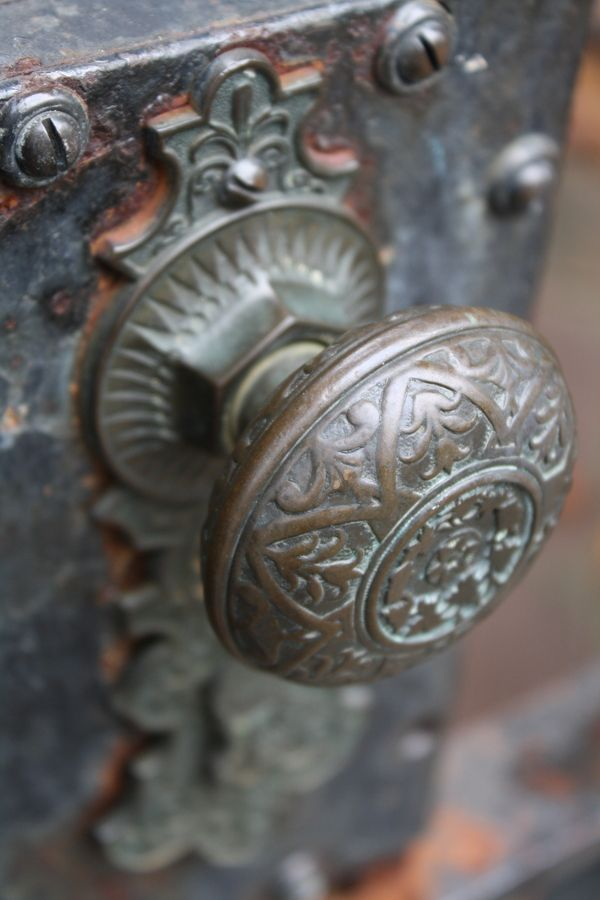 Ornate Metal Work On A Doorknob In The Garden District In New Orleans.