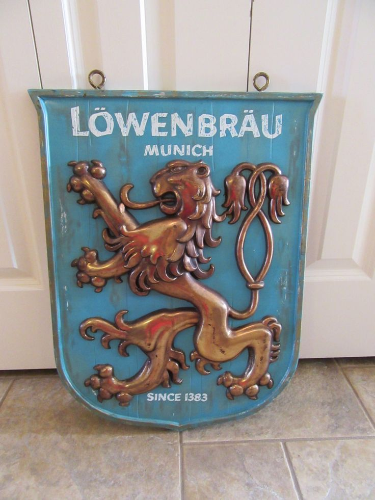 Vintage hanging Lowenbrau beer sign- great embossed design - weighty ,wall mountable plaque- unique, good condition by HeathersCollectibles on Etsy