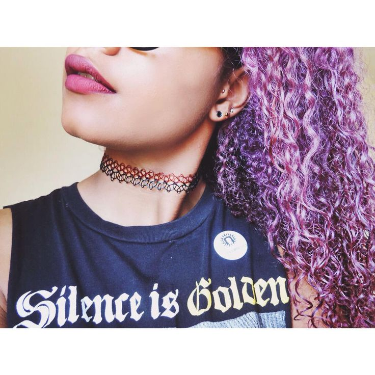 Small stretched ears and purple hair