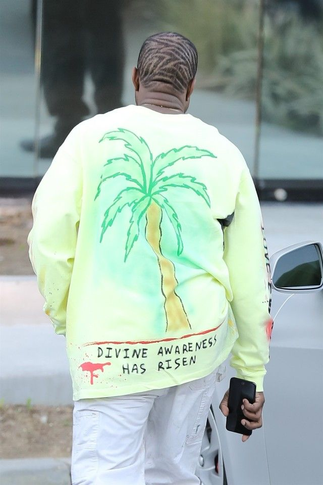 23aecbc1f Kanye West wearing Yeezy Wes Lang Wyoming L S Tee Frozen Yellow