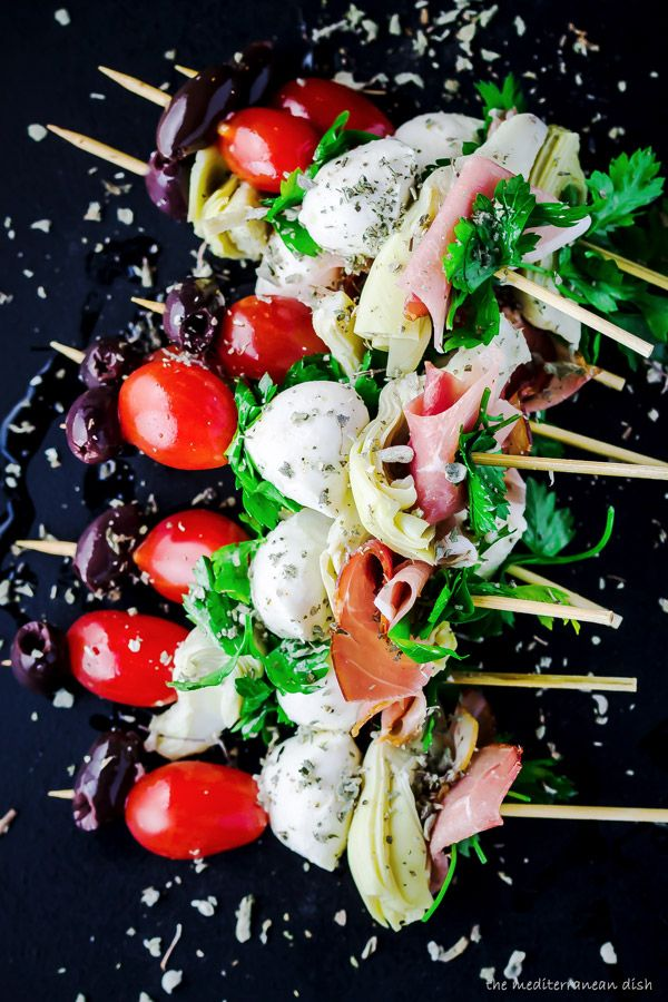 Antipasto skewers. Easy skewers of prosciutto, artichoke hearts, mozzarella balls, cherry tomatoes and olives. Perfect party appetizer!