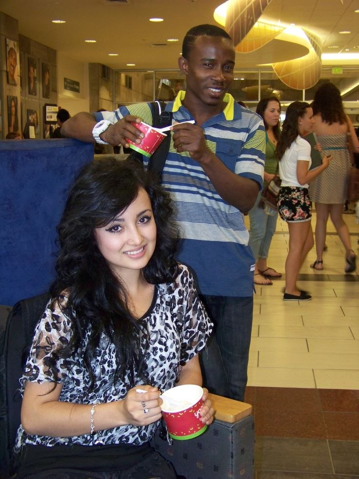 "FROM LEFT: Janeth Rodriguez and King Essel enjoyed free frozen yogurt while learning more about the clubs and resources offered at ACC during ""Get the Scoop"" on Aug. 27, 2013."