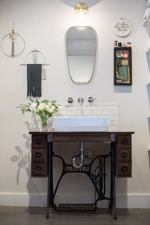 Boutique, custom vanity, Singer sewing machine with vessel sink.