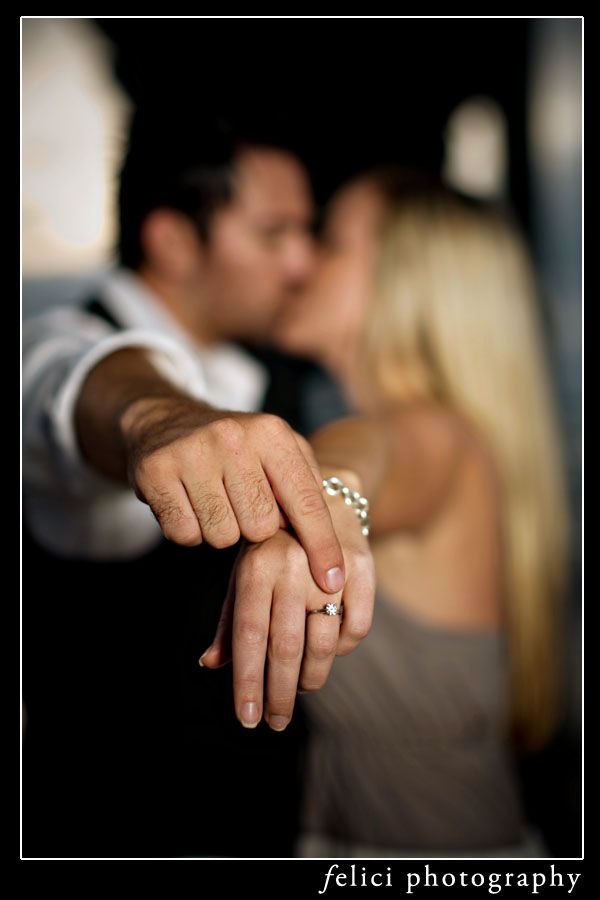 This is an adorable idea to show off the ring with them kissing faded in the background! ♥♥