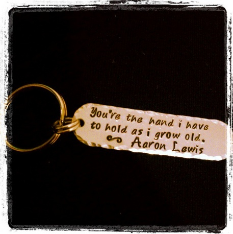 """Deana's husband customized a keychain with a lyric from Aaron's """"Tangled Up in You"""". Pretty romantic."""
