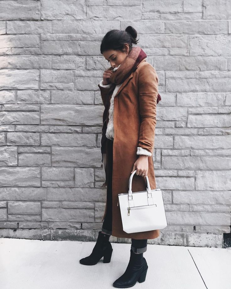 fall outfit detailed with brown trench coat and white handbag, big autumn scarf ans cute black boots