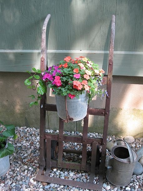 Hand dolly flower pot holder Anything can be used to hold flowers! This is an old hand truck that belonged to my uncle. A piece of copper wire shap...