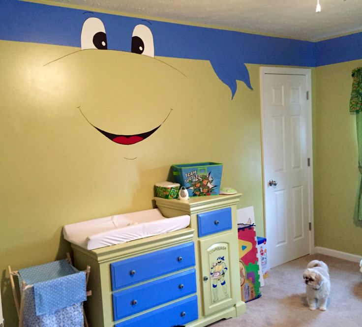 Green walls with blue border turned ninja turtle hand painted mural on baby nursery wall