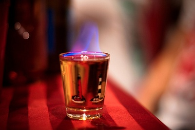 boozemixes:    Flaming Dr. Pepper.  Ingredients & Measurements:  1 Light Beer of choice  2 oz. Amaretto  151 Rum  Instructions:  Pour a glass half full with the light beer. Pour the amaretto in a shot glass until almost full. Float the 151 Rum on top of it. Light the 151, and drop the shot into the beer, chug immediately.