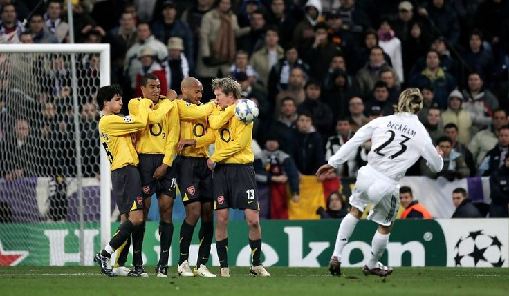 The Arsenal wall of Cesc Fabregas, Gilberto, Thierry Henry and Alexander Hleb deflect Madrid's David Beckham freekick during the UEFA Champions League Round of 16, First Leg match between Real Madrid and Arsenal at the Santiago Bernabeu Stadium on February 21, 2006 in Madrid, Spain. (Feb. 20, 2006 - Source: Getty Images Europe)