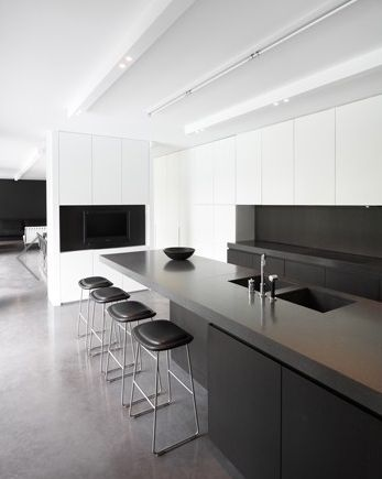 Sleek kitchen area in the Villa V & V in Bonheiden by Arjaan de Feyter _
