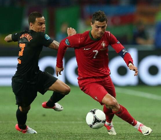 Portugal 2 Holland 1 in 2012 in Kharkiv. Cristiano Ronaldo leaves Gregory van der Wiel behind in Group B at Euro 2012.
