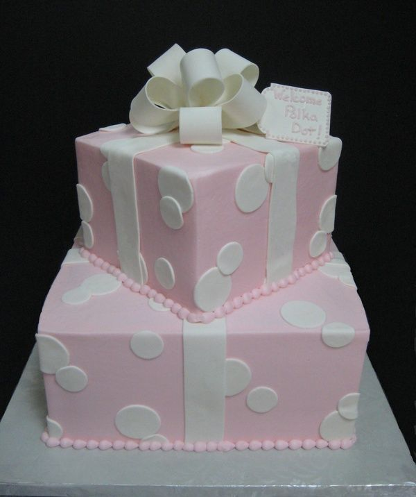 Adorable cake for a girl baby shower, with neon pink and purple