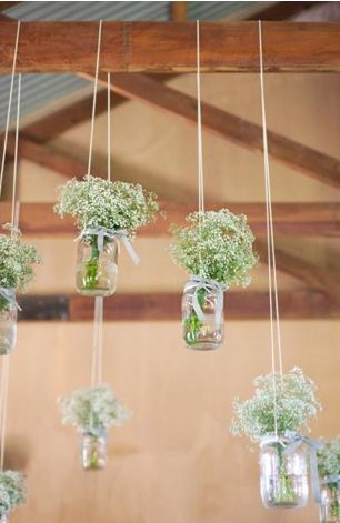 hanging glass with baby's breath...... #rustic #barnwedding