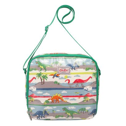 Dino Stripe Kids Lunch Bag | Packed lunches just got an upgrade with our kids lunch bags. We've updated the shape and added our Dino Stripe print, but kept the foil insulated lining and adjustable, durable strap. There's also a matching padded backpack! | Cath Kidston |