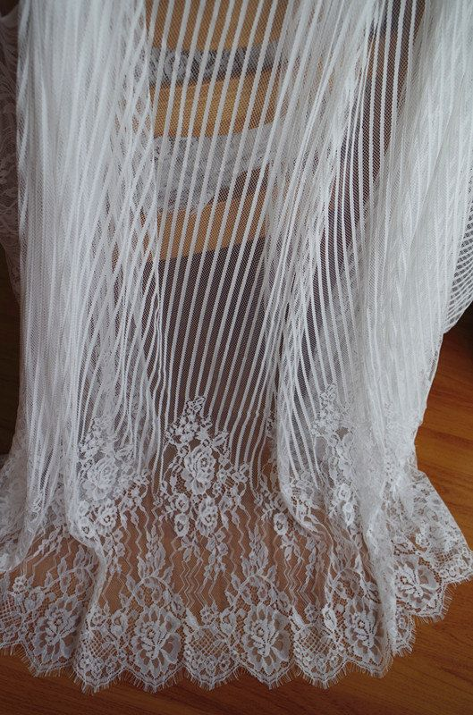 off white Chantilly lace fabric with scalloped edge