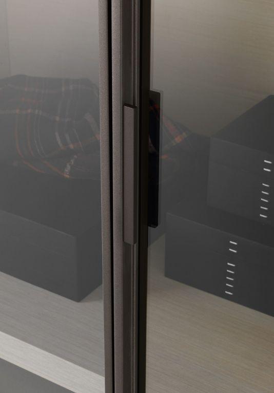 Wardrobes throughout + Smoked mirror details Poliform, wardrobe - Ego - designed by Giuseppe Bavuso (2010).