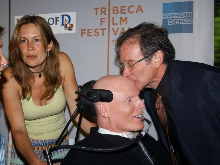Robin Williams kisses Christopher Reeve's head as Reeve's wife, Dana, and son Will look on before a Tribeca Film Festival screening of HOUSE OF D at the Tribeca Performing Arts Center in New York. Williams stars in the movie.