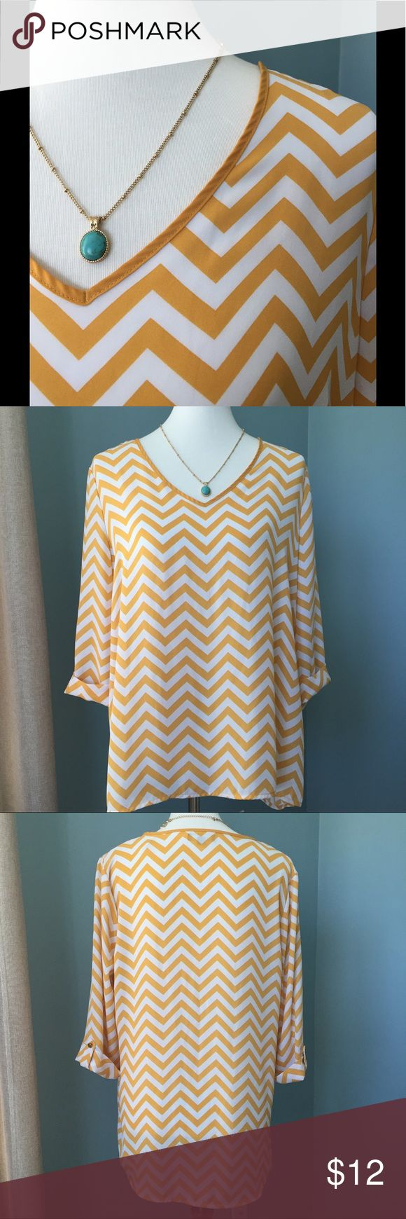 Kiara Chevron Top Lightweight and comfortable - gold/white chevron print - 100% poly - cuffed 3/4 sleeves w/ tabs - v-neck - 2small flaws in fabric (see pictures) Kiara Tops
