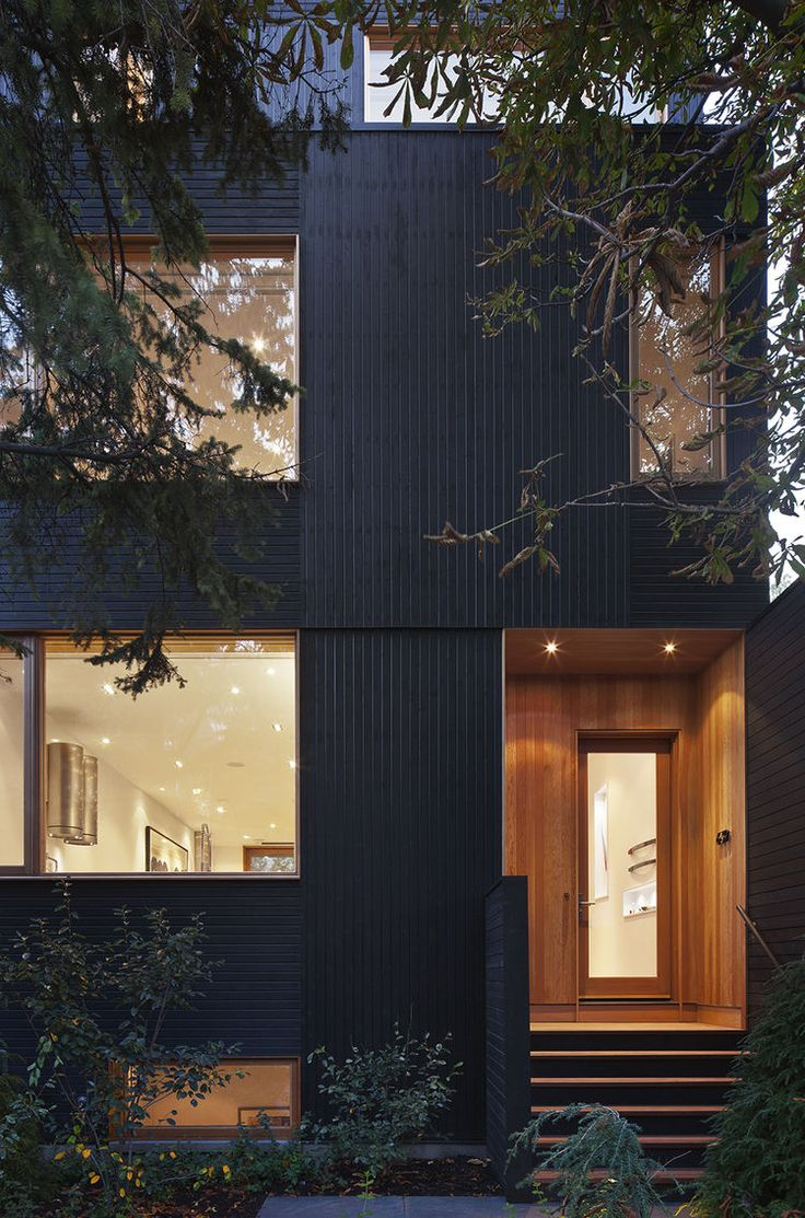 Douglas fir cladding around door of Toronto renovation by Modern Nest Design + Construction.