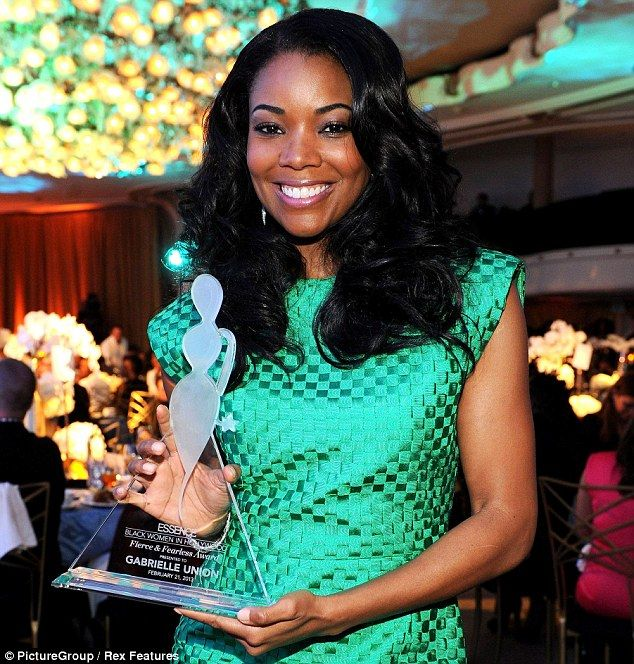 Got the gong: Gabrielle poses with her see-through statue