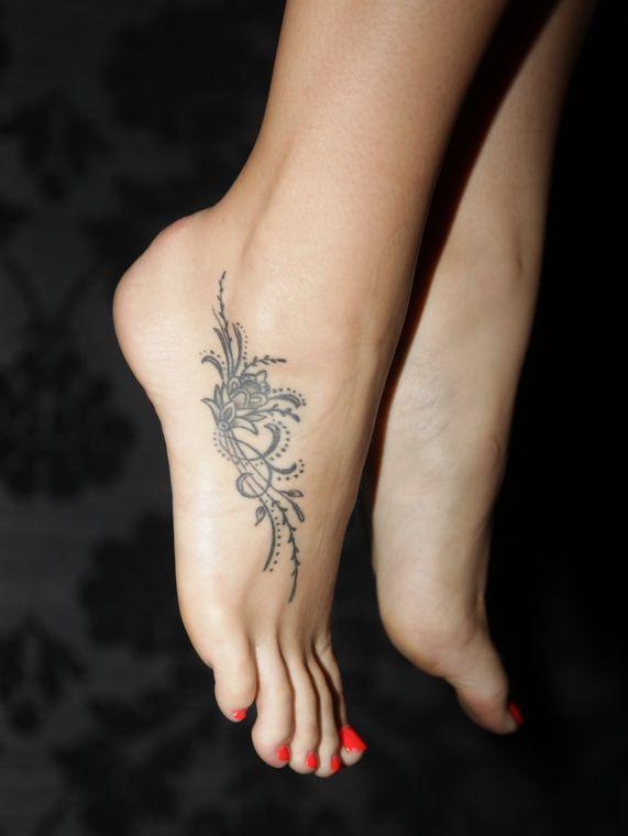 Very small tattoo writing foot