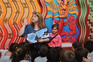 Bluff Community School principal Alison Cook  reading stories.