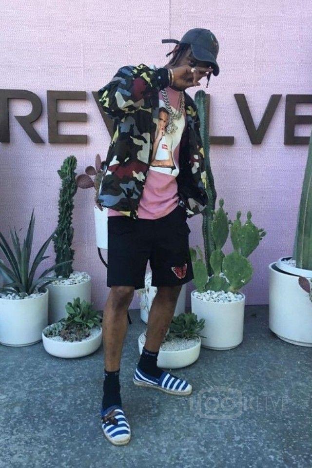 Travis Scott wearing  Valentino Camouflage Print Jacket, Supreme Morrissey T-Shirt, Gucci Embroidered Striped Espadrilles, Gucci Cotton Short With Butterfly, Fan Merchandise Travis Scott Anti Tour Cap