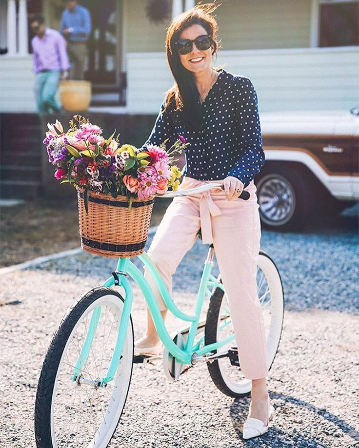 """Sarah Vickers on Instagram: """"Pedaling petals """" - navy polka dot blouse, blush trousers, pointed loafers"""