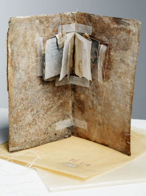 """Brigid Collins: """"Yield"""" A one-off Artist's Book, incorporating a found 'book' form, lens tissue, sandpaper, leaves, typewritten text, silver leaf, linen thread and text from the """"Tao Te Ching"""" by Lao Tsu (translated by Gia- Fu Feng and Jane English). (Vintage edition)."""