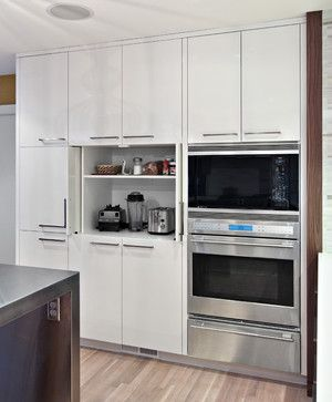 for microwave/ coffeemaker and toaster oven below/  pull out counter shelf....Sleek appliance garage contemporary-kitchen