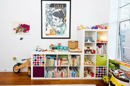 A friend in Dulwich had a fabulous home with similar decor, and used a similar system to store all her little boy's toys and bits and bobs in the communal areas. Worked a treat. Looks good too.