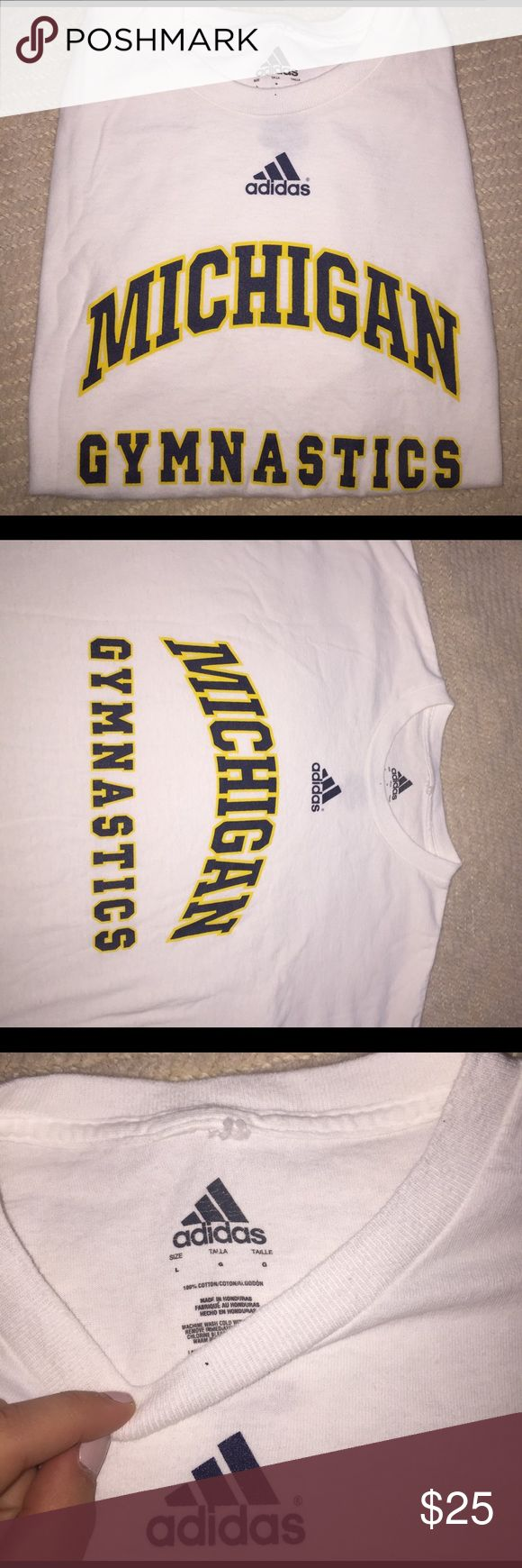 Michigan Gymnastics shirt Worn maybe two times, in great condition. Size child large. Adidas brand. Adidas Shirts & Tops Tees - Short Sleeve