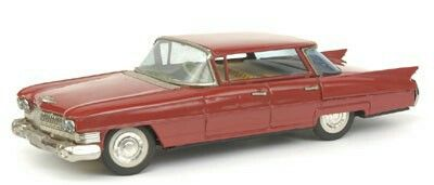A large tinplate model of a Cadillac 62 American Car by Bandai of Japan - brick red, bright work to front and rear and windscreen surrounds, detailed hubs, tin printed interior, steerable wheels, battery operated - Excellent model, almost 30cm long.