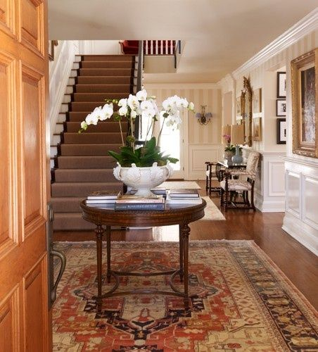 madgebettany: I always coveted a front hall big enough for a central table. Plus, orchids!